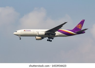 Samut Prakan, Thailand. January 10, 2019. Thai Airways International Boeing 777-200 Reg.HS-TJH on Final Approach for Landing at Suvarnabhumi Airport with Blue Sky.
