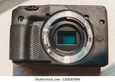 Samut Prakan, Thailand - January, 2019: Close up shot of APS-C (Crop Sensor) CMOS sensor in mirrorless camera with metallic mount and lens contact points