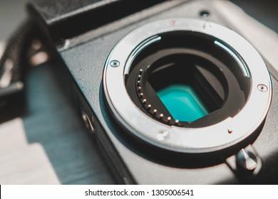 Samut Prakan, Thailand - January, 2019: Close up shot of Micro Four Third CMOS sensor in a mirrorless camera with metallic lens mount and contact pins