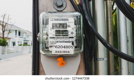 Samut Prakan, Thailand - January 4, 2019: Thai Metropolian Electricity Authority watt hour meter install on electricity pole in a village. This meter measure how much the house owner should pay bills.