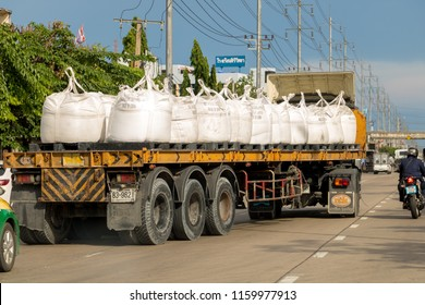 SAMUT PRAKAN, THAILAND, MAY 05 2018, a truck with a flatbed carries large bags filled with chemicals made in China. Carriage of Sodium Sulphate Anhydrous on the road in the city.