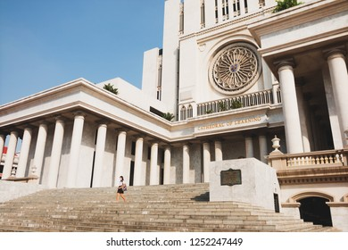Samut Prakan, Thailand - November 19th, 2018: Thai students walking down the central buildin of Assumption University Bangna Campus