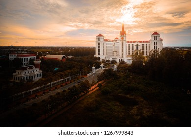 Samut Prakan, Thailand - September 4, 2018: Dormitory building at Assumption University of Thailand, a catholic university, during sunset with rays through cloud.