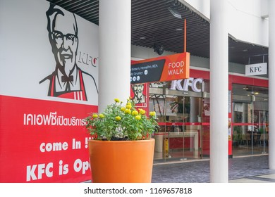 Samut Prakan ,THAILAND-October 17,2017:  In front of Kentucky Fried chicken restaurant with big Colonel Harland Sanders picture on wall