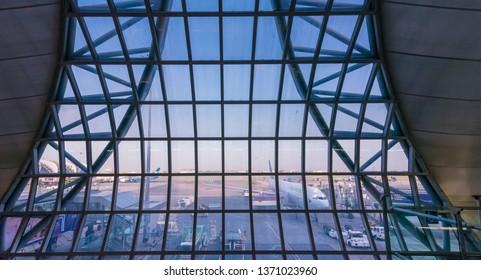 SAMUT PRAKAN,THAILAND - APRIL 13,2018 : View outside from airport window of departure gate at Suvarnabhumi International Airport or Bangkok Airport (BKK).