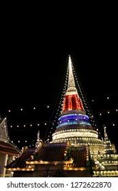 SAMUT PRAKAN,THAILAND - November 3,2018 :  Phra Samut Chedi Temple fair night scene, Beautiful light,temple fair at Wat Phra Samut Chedi at Samut Prakan province,Thailand.