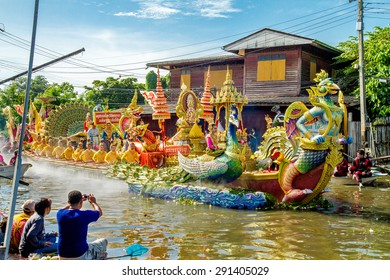 SAMUT PRAKAN,THAILAND-OCTOBER 18, 2013:The Lotus Giving Festival(Rap Bua) in Samut Prakan,Thailand. Devotees throw lotus flowers to boat procession that carry Buddha image on the end of Buddhist Lent.