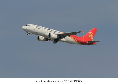 Samut Prakarn, Thailand. April 8, 2018. Shenzhen Airlines Airbus A320-214 Reg. B-6358 Taking Off from Suvarnabhumi Airport to China with Blue Sky