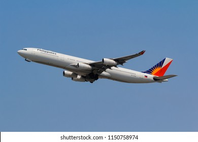 Samut Prakarn, Thailand. April 8, 2018. Philippine Airlines Airbus A340-313 Reg. RP-C3438 Taking Off from Suvarnabhumi Airport with Blue Sky