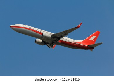 Samut Prakarn, Thailand. April 8, 2018. Shanghai Airlines Boeing 737-86D(WL) Reg. B-1742 Taking Off from Suvarnabhumi Airport to China with Blue Sky