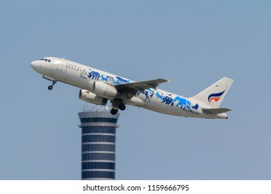 "Samut Prakarn, Thailand. April 8, 2018. Bangkok Airways Airbus A320-232 Reg. HS-PPH ""United for Wildlife"" special livery Taking Off from Suvarnabhumi Airport with Blue Sky"