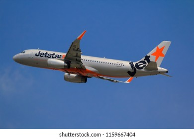 Samut Prakarn, Thailand. April 8, 2018. Jetstar Asia Airbus A320-232(WL) Reg. 9V-JSQ Taking Off from Suvarnabhumi Airport to Singapore with Blue Sky