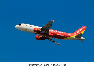 Samut Prakarn, Thailand. April 8, 2018. VietJetAir Airbus A320-214 Reg. VN-A680 Taking Off from Suvarnabhumi Airport to Vietnam with Blue Sky