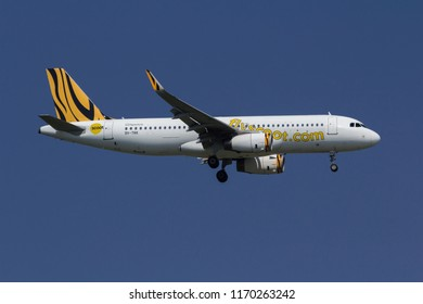 Samut Prakarn, Thailand. April 8, 2018.Scoot Airbus A320-232(WL)  Reg. 9V-TRK from Singapore on Short Final Approach for Landing at Suvarnabhumi Airport with Blue Sky