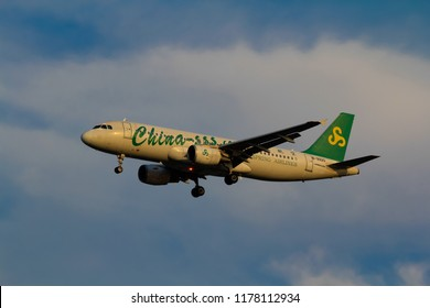 Samut Prakarn, Thailand. April 8, 2018. Spring Airlines Airbus A320-214 Reg. B-9920 from China on Final Approach for Landing at  Suvarnabhumi Airport with Blue Sky
