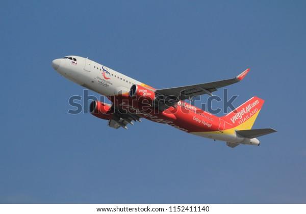 Samut Prakarn, Thailand. April 8, 2018. ThaiVietjetAir Airbus A320-214(WL) Reg. HS-VKC Taking Off from Suvarnabhumi Airport with Blue Sky