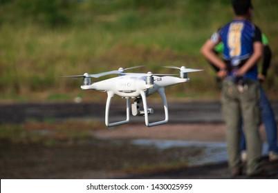 Samut Sakhon, Thailand - 1 June 2019: DJI Phantom 4 drone test drive. And power up to shoot high angle shots.