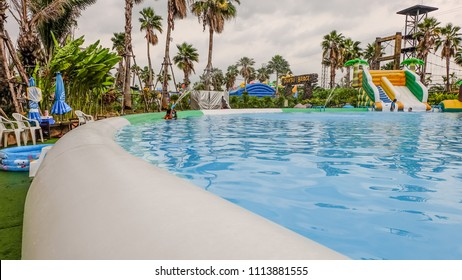 SAMUT SAKHON, THAILAND - APRIL 7, 2018: Inflatable Swimming Pool in Pantai Norasingh Water Park, New recreation in Samut Sakhon, Thailand. The Park is built to the standards equipment.