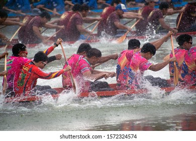 SAMUT SAKHON ,THAILAND - AUGUST 24,2019 : Unidentified rowers in native Thai long boats compete during King's Cup Native Long Boat Race Championship in Samut Sakhon ,Thailand. Note: Slight blurriness.