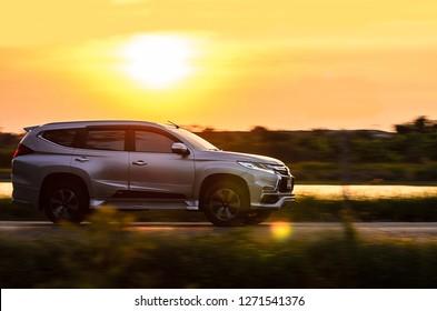 Samut Sakhon, Thailand - December 2018: MITSUBISHI PAJARO SPORT Motion image, car running on the road with the sunset background, on 31 December 2018 at Samut Sakhon, Thailand.