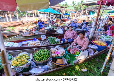 SAMUT SONGKHRAM, THAILAND - 2015 December 27: Unidentified tourists and merchants on vintage boats at Tha Kha Floating Market in Samut Songkhram, Thailand.