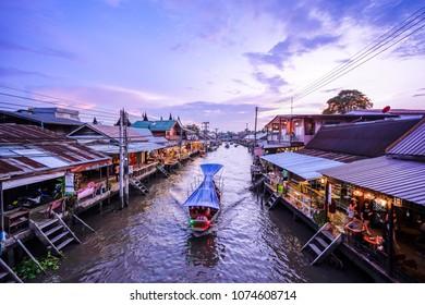 Samut Songkhram, Thailand - April 20, 2018 : Amphawa floating market in Samut Songkhram, Thailand. It is one of the most popular floating markets in Thailand.