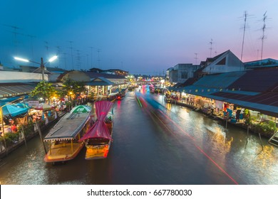 SAMUT SONGKHRAM, THAILAND - DEC 7 : Local merchant sell food ,fruits and product at Thaka floating market,on Dec 7,2013 in Samutsongkhram,Thai land. Thaka is a popular tourist attraction.