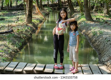 Samut Songkhram Thailand - March 19, 2019:Asian child cute girl Travel in coconut plantation