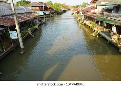 "SAMUT SONGKHRAM ,THAILAND - MARCH 19,2018 : Amphawa floating market is the most popular in Thailand. The market is near ""Wat Amphawa Chetiyaram"" temple. The Amphawa canal is on the Mae Klong river."