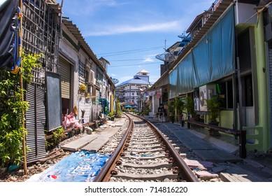 Samut Songkhram, Thailand-SEP 12,2017: The famous railway market or folding umbrella market at Maeklong, Thailand, One of famous market landmark in Thailand.