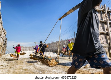 Sa-mute Sa-khan Province, Thailand - April 12, 2017 : Saline farmers start salting in October or November, and salt is collected. In April, a career in salt farming is reserved for Thai people.