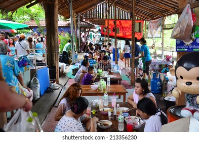 SAMUTPAKARN THAILAND - AUGUST 10 : Thai people go to Bangnamphung Floating Market for travel and shopping on August 10, 2014 in Samutprakarn Thailand