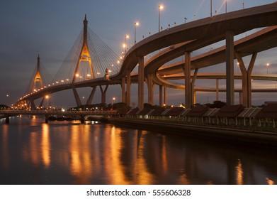 SAMUTPRAKAN ,THAILAND - DECEMBER 27,2015 : Twilight scenes of The Bhumibol Bridge,also known as the Industrial Ring Road Bridge is part of the 13 km . The bridge crosses the Chao Phraya River twice.