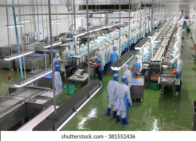 Samutprakarn, Thailand- FEBRUARY 16, 2016: Workers are preparing shrimp in a line in a seafood factory in Thailand.
