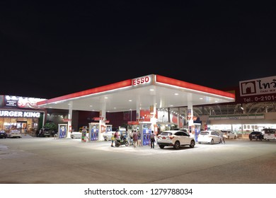 Samutprakarn, Thailand - Jan 6, 2019: ESSO (Exxon Mobile) gas station at night background. Esso gas stations and products including gasoline, diesel, motor oil, gift cards, credit cards and more.