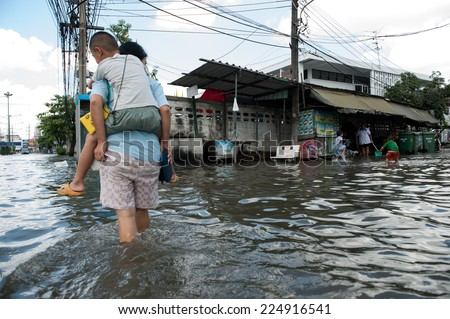 SAMUTPRAKARN, THAILAND - NOVEMBER 08: Heavy flooding from monsoon rain and tide from sea in Samutprakarn near Bangkok on November 8, 2009 in Samutprakarn, Thailand.