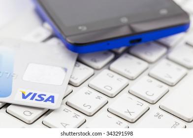 Samutsakhon, THAILAND - December 22, 2015: Photo of a VISA card on a keyboard.