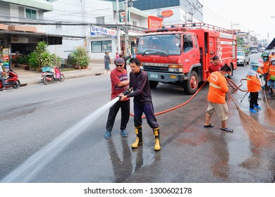 Samutsakhon, Thailand - January 31,2019 : Many people with water truck are cleaning on the road during Pm 2,5 dust problem in Thailand