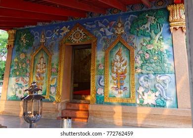 Samutsakhon ,Thailand-December 6,2017 : Beautiful art wall of Ordination Hall in Wat nangsao , No window and Single door hard to see in thailand
