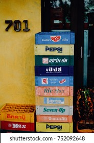 SAMUTSONGKRAM, THAILAND - OCTOBER 1, 2017 : Many brand of plastic crate or packing case aerated soft drink in Thai word.