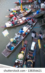 SAMUTSONGKRAM,THAILAND-SEPT 6 : Trader's boats in Amphawa floating Market in evening and most famous floating market and cultural tourist destination on September 6, 2012 in Samutsongkram, Thailand.