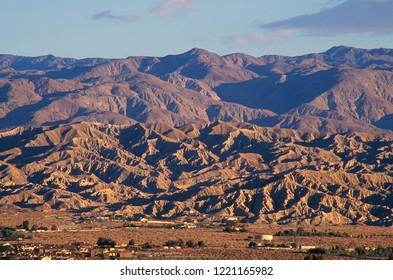 San Andreas geologic fault line in Coachella Valley, California.  Zoom lens to get the full picture of the ominous power of plate movement.  Sunrise.  After storm passes bye for clear atmosphere.