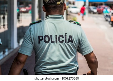 SAN ANDRES ISLAND, Colombia _ Circa March 2017. Police Officers Walking on the Sidewalk Downtown in San Andres Island During the Afternoon
