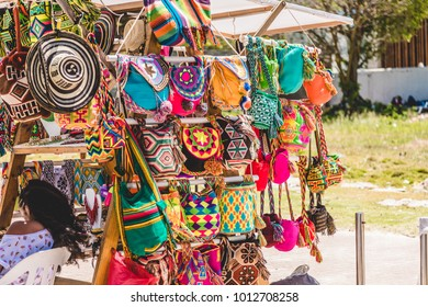 SAN ANDRES ISLAND, Colombia _ Circa March 2017.  Closeup of a Stand into a Small Street Market Along the Beach Selling Clothing, Hats, Bags and Jewellery.