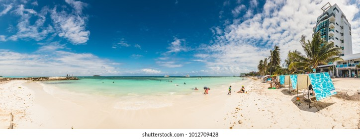 SAN ANDRES ISLAND, Colombia _ Circa March 2017.  Panorama of the Beach, Palm Trees and few People Walking on the Sand on San Andres Island, Colombia.