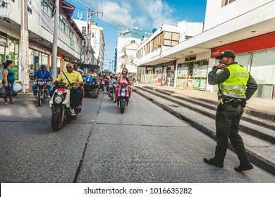 SAN ANDRES ISLAND, Colombia _ Circa March 2017. Policeman Downtown San Andres During Rush Hour and Traffic with Motorcycles and Scooters Everywhere.
