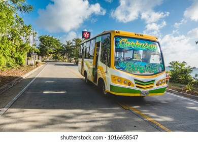 SAN ANDRES ISLAND, Colombia _ Circa March 2017.  Public Transportation Bus doing the Round Trip All Around the Island. All kind of Vehicles use this Route