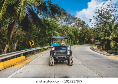 SAN ANDRES ISLAND, Colombia _ Circa March 2017. Tourists in a Golf Cart. There is a Road that do the Round Trip All Around the Island. All kind of Vehicles use this Route