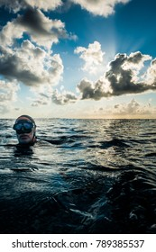 SAN ANDRES ISLAND, Colombia _ Circa March 2017. Freedivers at the surface During a Beautiful Sunset in the Caribbean Ocean