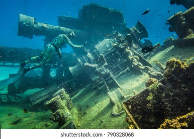 SAN ANDRES ISLAND, Colombia _ Circa March 2017. Freediver Filming a Shipwreck with his Cafo Wet Suit in Caribbean Sea